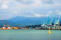 Batumi harbor with colorful cranes stock photos