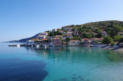 Harbor and beach of romantic Assos, Kefalonia, Greece. View of harbor and beach of romantic Assos, Kefalonia, Greece Stock Photography