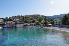 Harbor and beach of romantic Assos, Kefalonia, Greece Stock Photos