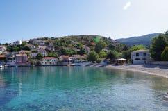 Harbor and beach of romantic Assos, Kefalonia, Greece. View of harbor and beach of romantic Assos, Kefalonia, Greece stock photos