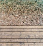 Harbor board and deck path made of wood with sea shore. Background Stock Photo