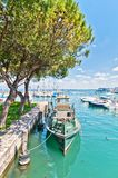 Harbor with boat in Desenzano on lake Garda, Italy Royalty Free Stock Photography