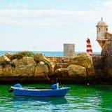 Harbor. Boat in a Quiet Harbor on the Atlantic Coast of Portugal Stock Photos