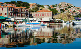 Harbor with boats at Molyvos Greece. Reflections of colorful boats in the harbor at Molyvos on the island of Lesvos stock photo