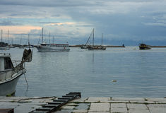 Harbor with boats after rain in Porec in Croatia. Royalty Free Stock Photos