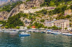 Harbor with boats and yachts of Amalfi village colorful houses, located on the rock, Amalfi coast, Sorrento, Italy. View from the sea on the beautiful stock photos