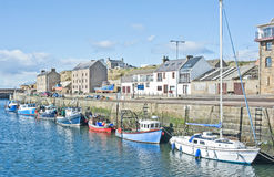 Harbor at Burghead. Burghead harbor with fishing boats tied up against the quay Royalty Free Stock Images