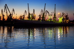 Harbor / Cargo / Silhouette of  Cranes at Sunset Stock Photography