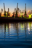 Harbor / Cargo / Silhouette of  Cranes at Sunset Royalty Free Stock Photography