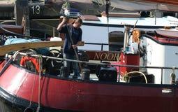 In the harbor of the citty of Harlingen. Netherlands, Harlingen,-june 2016: Work on the brown fleet Stock Photography