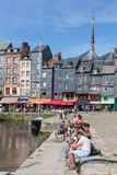 Harbor city Honfleur with moored sailing ships and relaxing people Royalty Free Stock Photo