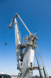 Harbor crane. Big harbor crane in the background of blue sky Royalty Free Stock Photography