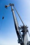 Harbor crane. Big harbor crane in the background of blue sky Stock Image