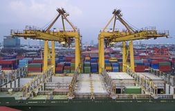 Harbor crane being Loading on container ship in warehouse port . Stock Image