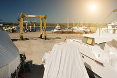 Harbor. Crane and boats on harbor Stock Photography