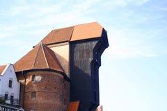"Harbor crane in GdaÅ""sk, Poland. Medieval harbor crane looming over the water of Motława river, Gdańsk. Poland stock image"