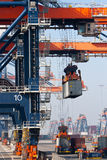 Harbor crane lifting container Royalty Free Stock Images