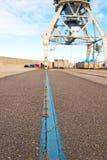 Harbor crane on rails Stock Photography