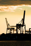 Harbor crane silhouettes Stock Photography