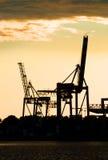 Harbor crane silhouettes stock photography