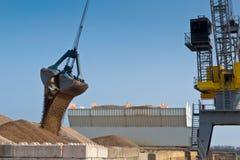 Harbor crane unloading ship Stock Photos