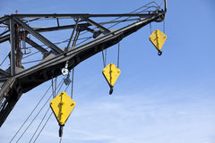 Harbor crane with yellow hooks Stock Photos