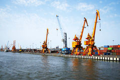 Harbor cranes. Cranes at harbor waiting for a ship Stock Photos