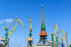 Harbor cranes on blue sky background Stock Image