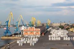 Harbor cranes and cargo Stock Photos
