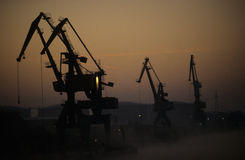 Harbor cranes, fine arts. Cranes in the harbor of Lünen in early morning royalty free stock photography