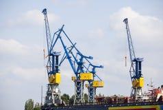 Harbor Cranes in Hamburg, Germany. Shipyard with tall cranes in Hamburg Harbor, Germany Royalty Free Stock Image