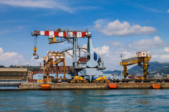 Harbor cranes in loading and unloading containers Royalty Free Stock Photos