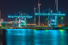 Harbor cranes at night Stock Photo