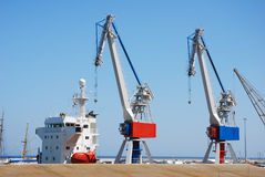 Harbor cranes with ship. At Santa Cruz, Canary islands Stock Images