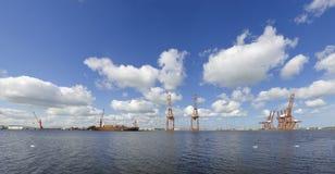 Harbor cranes with ship Stock Photos