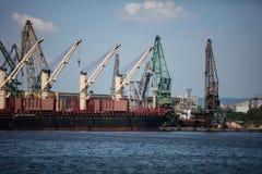 Harbor cranes working Stock Photo