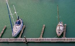 Harbor docks in Vlissingen with two typical dutch boats, Zeeland, the Netherlands stock images