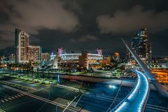 The Harbor Drive Pedestrian Bridge and downtown skyline at night, in San Diego, California stock image
