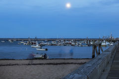 Harbor at Dusk. Provincetown harbor with boats at Dusk. Glowing moon Stock Photo