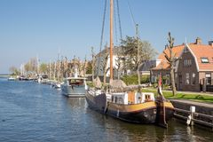 Harbor Dutch city Medemblik with historical wooden sailing ship. Harbor Dutch city Medemblik with old historical wooden sailing ship Royalty Free Stock Photo