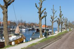 Harbor Dutch city Medemblik with historical wooden sailing ship. Harbor Dutch city Medemblik with old historical wooden sailing ship Stock Photography