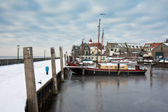 Harbor of Dutch fishery village Urk in wintertime. Snowed harbor of Dutch fishery village Urk in wintertime stock images