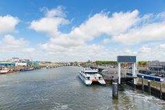 Harbor Dutch Harlingen. Landscape in harbor Harlingen with the fast ferry boat to wadden island Terschelling Stock Image