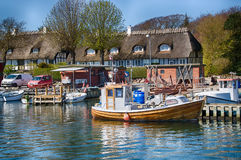 The harbor of Dyreborg with old ships. At the cosy harbor of Dyreborg, there is many old buildings and ships Stock Images