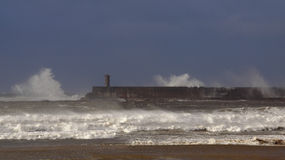 Harbor entrance on a stormy day Stock Photography