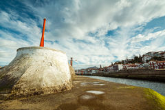 Harbor Entry. Entry of the Saint Jean de Luz harbor, the Ciboure village on the side and the Rhune Mountain in the distance Royalty Free Stock Images