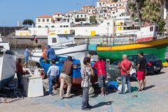 Harbor with fishermen and fishing ships in Funchal, Portugal stock images