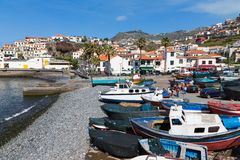Harbor with fishermen and fishing ships in Funchal, Portugal Royalty Free Stock Images
