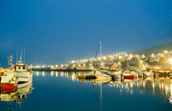 Harbor fishing boats at night with beautiful lights. Siglufjordur, Iceland. Royalty Free Stock Photos