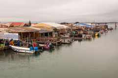 Harbor with fishing boats with oysters. In leucate Royalty Free Stock Photos